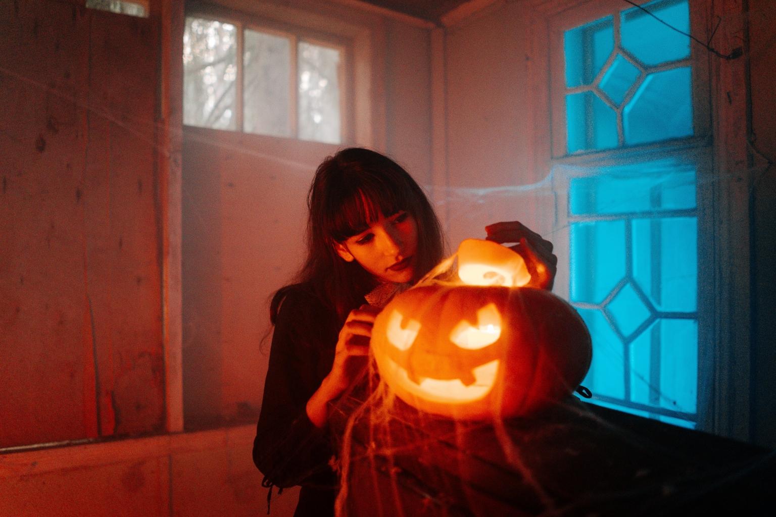 girl holding a halloween pumpkin